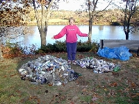 Dona with mountain of collected bottles