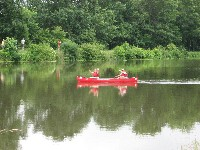tandem canoe in canal_paddlers waving