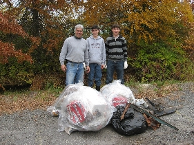 3 Volunteers with pile of trash bags