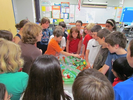 Tammy Gilpatrick & Clough Elementary students with Watershed Model