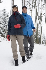 couple walking in woods in winter