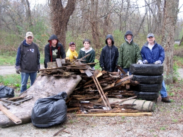 Group of Riverbend Farm volunteers posing with collected trash