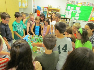 Clough Elementary School 4th graders 'raining' on the watershed model